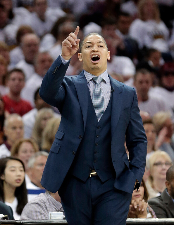 . Cleveland Cavaliers head coach Tyronn Lue yells instructions to players in the first half in Game 1 of a first-round NBA basketball playoff series against the Indiana Pacers, Saturday, April 15, 2017, in Cleveland. (AP Photo/Tony Dejak)