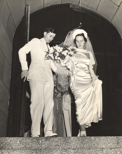 Mom & Dad on church steps after wedding