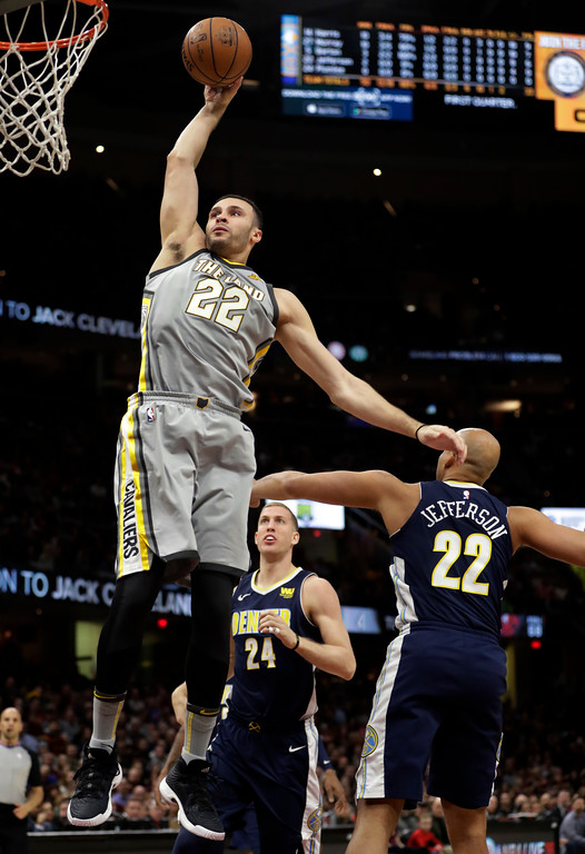 . Cleveland Cavaliers\' Larry Nance Jr. (22) dunks the ball against the Denver Nuggets in the first half of an NBA basketball game, Saturday, March 3, 2018, in Cleveland. (AP Photo/Tony Dejak)