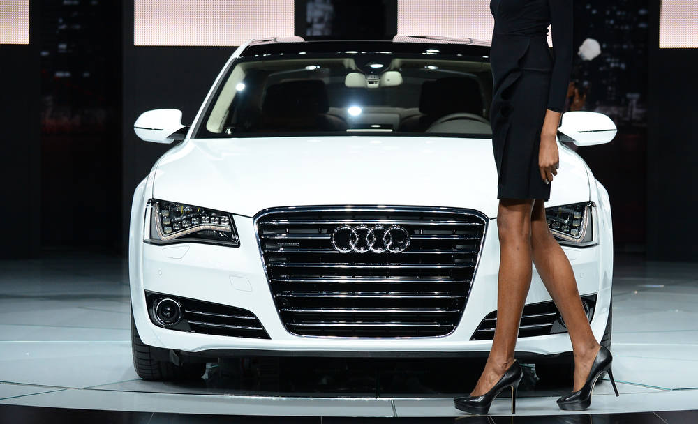 Description of . A model walks past an Audi A8L TDI displayed on media preview day at the Los Angeles Auto Show on November 28, 2012 in Los Angeles, California. The show opens to the public from November 30 to December 9. AFP PHOTO / Frederic J.  BROWN/AFP/Getty Images