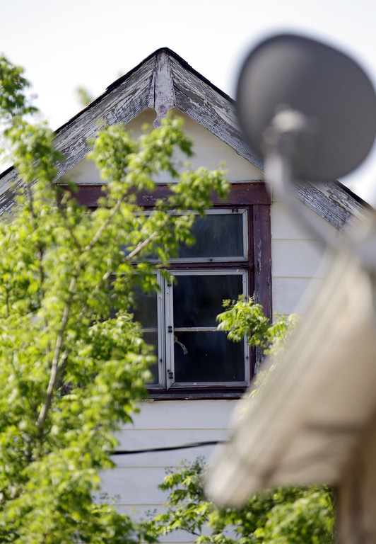 . The upper floor window is covered where three women were held in Cleveland, Ohio, Thursday, May 9, 2013.  Ariel Castro was charged with four counts of kidnapping and three counts of rape.     (AP Photo/David Duprey)