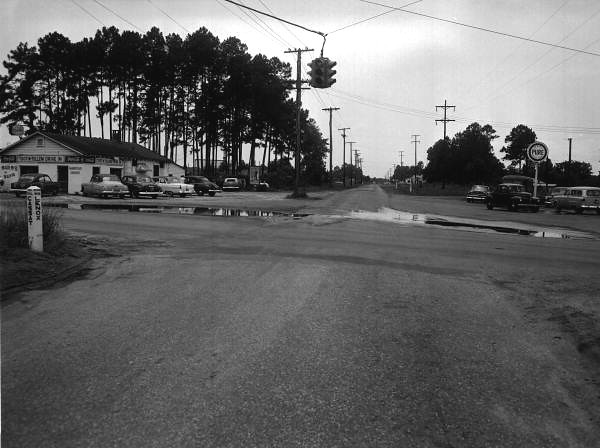 RF00688-View of Toot-N-Tellem Drive-in restaurant and Pure gas station at the intersection of Cassat Avenue and Lenox Avenue-1950s-Fisher Collection.jpg
