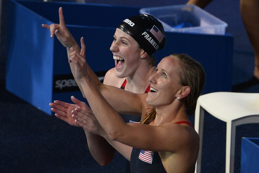 . US swimmers Jessica Hardy (R) and Missy Franklin celebrate after winning the final of the women\'s 4x100-metre medley relay swimming event in the FINA World Championships at Palau Sant Jordi in Barcelona on August 4, 2013. PIERRE-PHILIPPE MARCOU/AFP/Getty Images