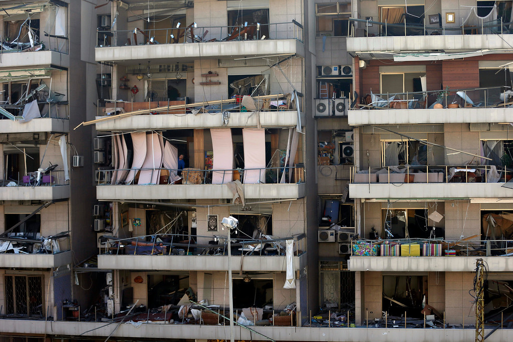 . The facade of apartment buildings are damaged by an explosion near the Kuwaiti Embassy and Iran\'s cultural center, in the suburb of Beir Hassan, Beirut, Lebanon, Wednesday, Feb. 19, 2014. (AP Photo/Hassan Ammar)