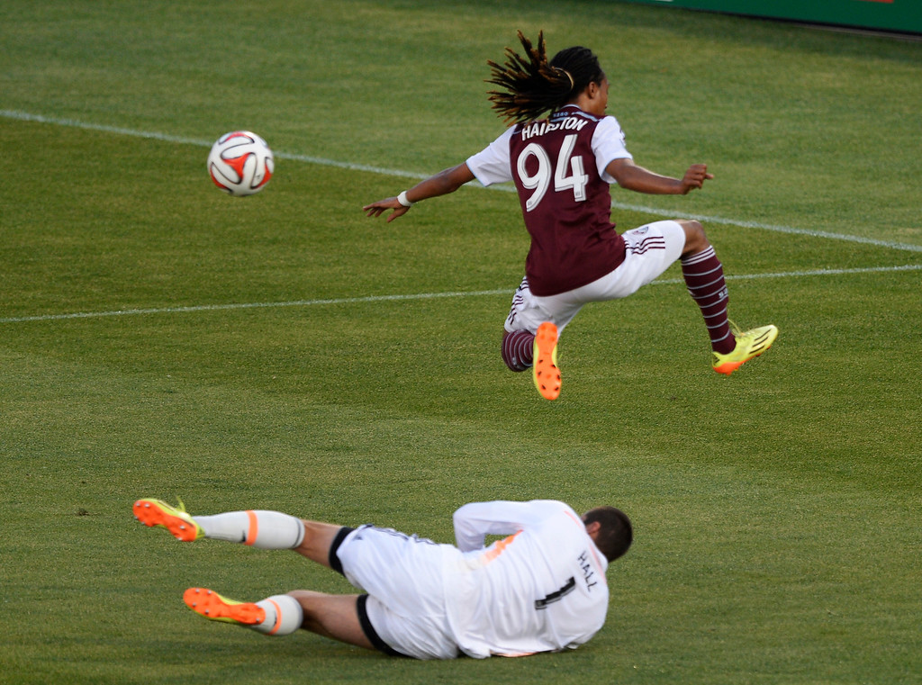 . COMMERCE CITY, CO - JUNE 01: Colorado Rapids midfielder Marlon Hairston (94) sails over Houston Dynamo goalkeeper Tally Hall (1) as he tries to get to the ball during the second half June 1, 2014 at Dick\'s Sporting Goods Park. (Photo by John Leyba/The Denver Post)