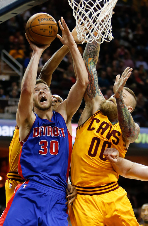 . Detroit Pistons\' Jon Leuer (30) goes up for a shot against Cleveland Cavaliers\' Chris Andersen (00) during the second half of an NBA basketball game Friday, Nov. 18, 2016, in Cleveland. The Cavaliers won 104-81. (AP Photo/Ron Schwane)