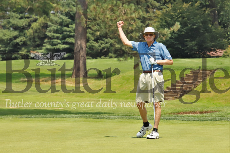 George Bilowick celebrates sinking a putt on the 2 hole at Butler Country Club Monday. Seb Foltz/Butler Eagle  (home course)