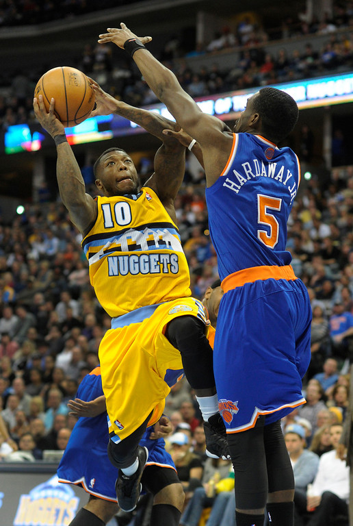 . DENVER, CO. - NOVEMBER 29: Denver guard  Nate Robinson (10) looked for a way past New York defender Tim Hardaway Jr. (5) in the second half. The Denver Nuggets defeated the New York Knicks 97-95 at the Pepsi Center Friday night, November 29, 2013. Photo By Karl Gehring/The Denver Post