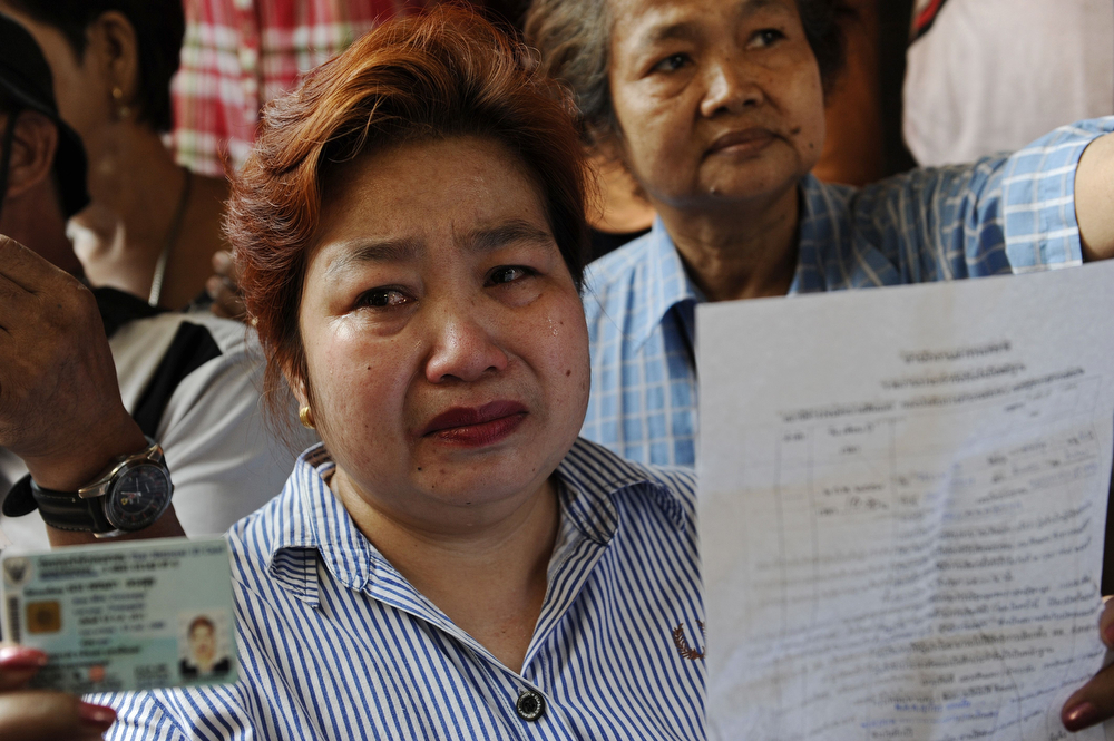 . A frustrated Thai voter holds her national identification card as she stands outside a closed polling station because voting was cancelled after anti-government protesters prevented the delivery of election material in downtown Bangkok on February 2, 2014.  Anti-government protesters blocked voting in dozens of constituencies in tense Thai elections on February 2 overshadowed by pre-poll bloodshed, an opposition boycott and fears of protracted political limbo. (CHRISTOPHE ARCHAMBAULT/AFP/Getty Images)