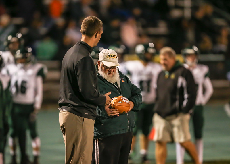Mr. Greiner presented a game ball by AD Casey wolf for his 50 years of service at Amherst football games.jpg