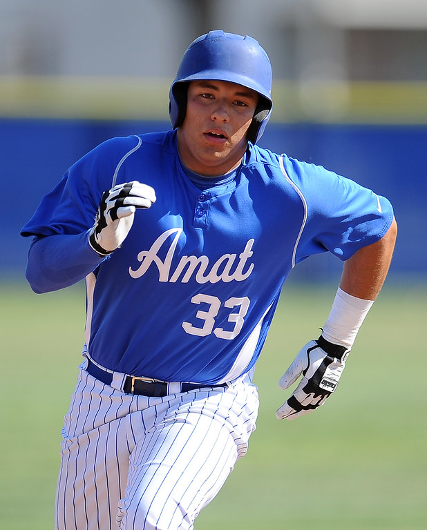 . Bishop Amat\'s Bryan Menendez RBI triple in the first inning of a prep baseball game against St. Paul at Bishop Amat High School on Friday, April 19, 2012 in La Puente, Calif. Bishop Amat won 3-2.    (Keith Birmingham/Pasadena Star-News)