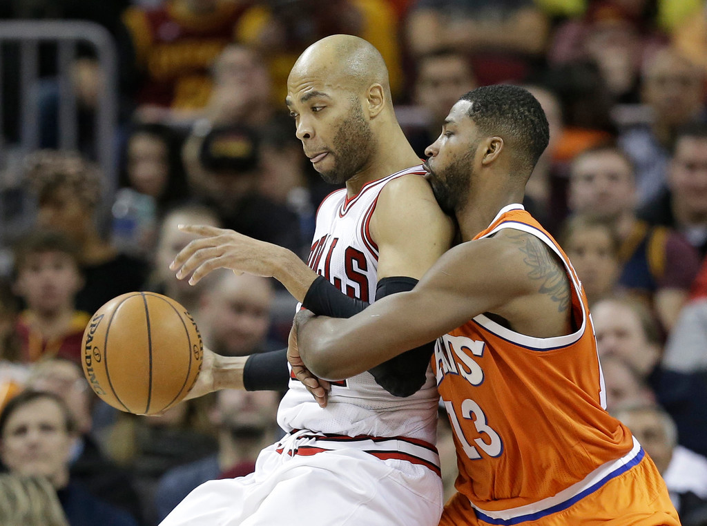 . Chicago Bulls\' Taj Gibson, left, drives against Cleveland Cavaliers\' Tristan Thompson in the first half of an NBA basketball game, Wednesday, Jan. 4, 2017, in Cleveland. (AP Photo/Tony Dejak)