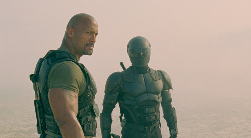 . Left to right: Dwayne Johnson plays Roadblock and Ray Park plays Snake Eyes in G.I. JOE: RETALIATION, from Paramount Pictures, MGM, and Skydance Productions. (Jaimie Trueblood/Paramount Pictures)