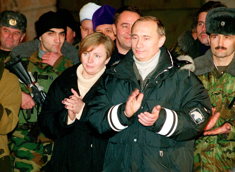 . Russia\'s then acting President Vladimir Putin and his wife, Lyudmila, applaud during a concert after an award ceremony in Gudermes, 30 km (19 miles) east of Grozny, in this undated file photo. Putin and his wife said on state television on Thursday that they had separated and their marriage was over after 30 years. REUTERS/Stringer/Files