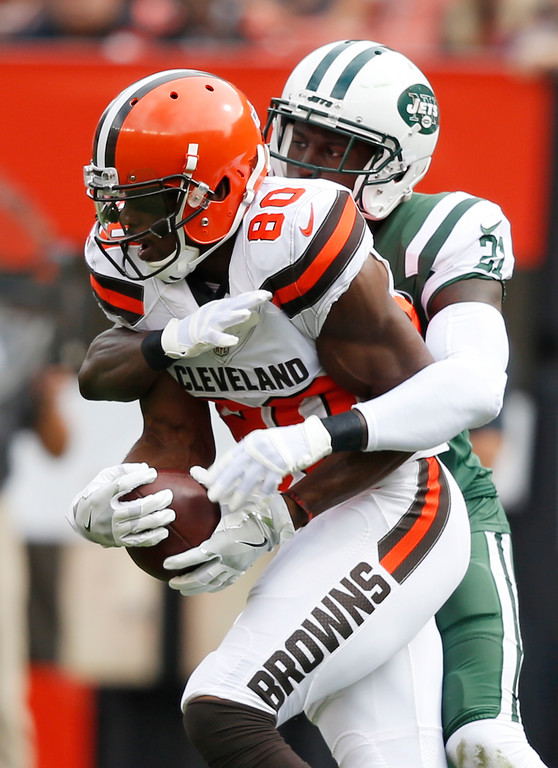 . Cleveland Browns wide receiver Ricardo Louis, left, is tackled by New York Jets cornerback Morris Claiborne during the first half of an NFL football game, Sunday, Oct. 8, 2017, in Cleveland. (AP Photo/Ron Schwane)
