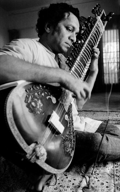 . FILE - In this 1967 file photo, Ravi Shankar plays his sitar in Los Angeles. Shankar, the sitar virtuoso who became a hippie musical icon of the 1960s after hobnobbing with the Beatles and who introduced traditional Indian ragas to Western audiences over an eight-decade career, died Tuesday, Dec. 11, 2012. He was 92. (AP Photo, File)