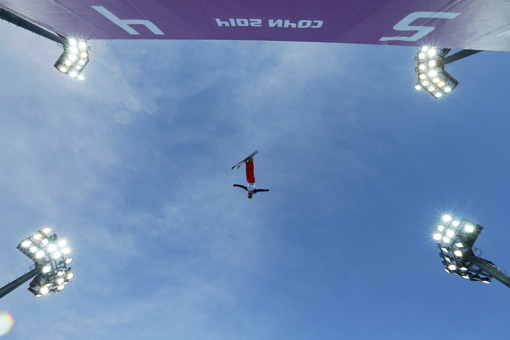 . China\'s Wu Chao jumps during men\'s freestyle skiing aerials training at the Rosa Khutor Extreme Park, at the 2014 Winter Olympics, Saturday, Feb. 15, 2014, in Krasnaya Polyana, Russia. (AP Photo/Andy Wong)