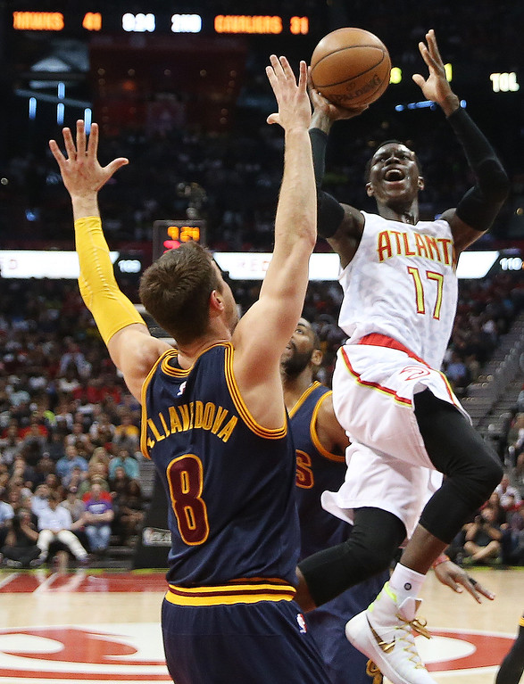 . Atlanta Hawks guard Dennis Schroder (17) shoes over Cleveland Cavaliers guard Matthew Dellavedova (8) in the first half of Game 4 of the second-round NBA basketball playoff series, Sunday, May 8, 2016, in Atlanta. (AP Photo/John Bazemore)