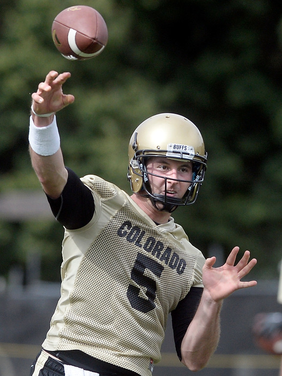 . University of Colorado quarterback Connor Wood throws a pass during the second fall football practice on Wednesday, Aug. 7, at the CU practice fields. For more photos of practice go to www.dailycamera.com Jeremy Papasso/Camera