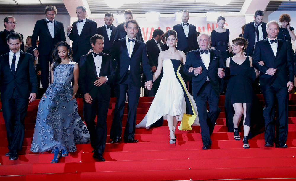 ". Cast members Billy Crudup, Zoe Saldana, director Guillaume Canet, cast members Clive Owen, Marion Cotillard, James Caan, Lili Taylor and Noah Emmerich leave after the screening of the film ""Blood Ties\"" during the 66th Cannes Film Festival in Cannes May 20, 2013.              REUTERS/Yves Herman"