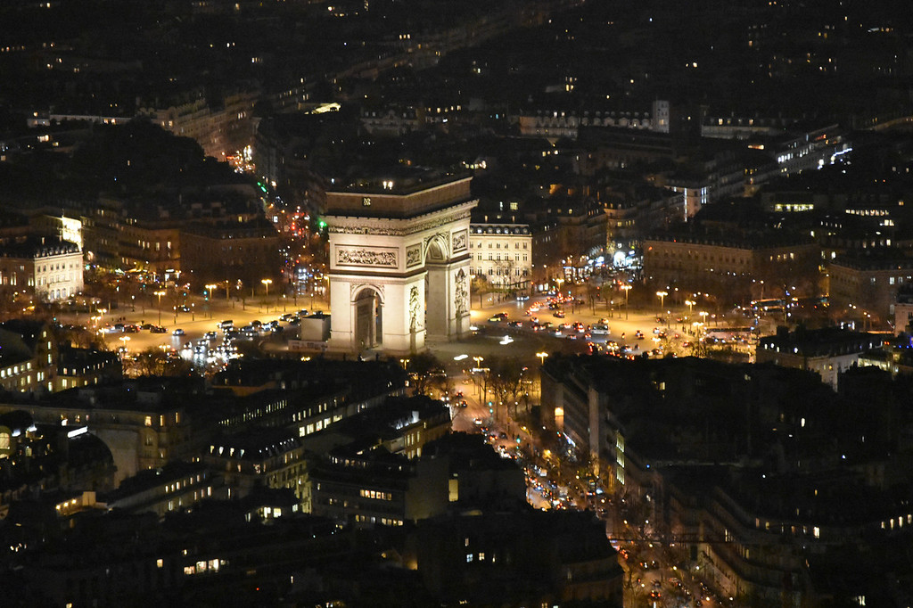 View of Arc du Triomphe from Eiffel tower at night