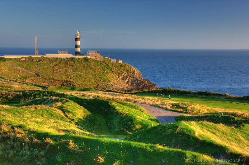 View of Old Head lighthouse and 17th green, from the clubhouse patio.