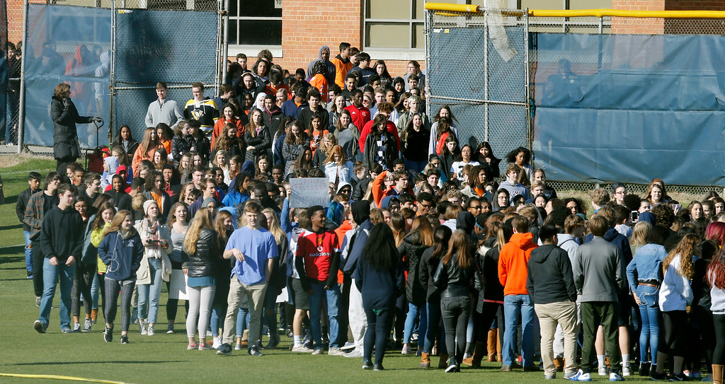 . Students from Douglas Freeman High School walk out of school to protest gun violence in Richmond, Va., Wednesday, March 14, 2018. Young people in the U.S. walked out of school to demand action on gun violence Wednesday in what activists hoped would be the biggest demonstration of student activism yet in response to last month\'s massacre in Florida. (AP Photo/Steve Helber)