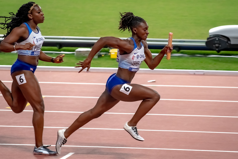 Dina Asher-Smith takes the baton in the Women's 4x100m relay during day nine of 17th IAAF World Athletics Championships Doha 2019 at Khalifa International Stadium on October 05, 2019 in Doha, Qatar. Photo by Tom Kirkwood/SportDXB
