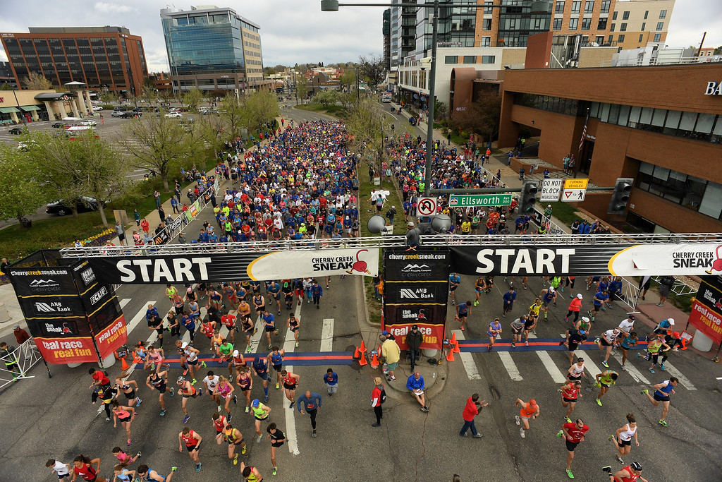 . DENVER, CO - APRIL 24:  Hundreds of runners begin the 5 mile race along Steele Street during the 34th annual Cherry Creek Sneak road races on April 24, 2016 in Denver, Colorado. The day\'s races included a 10 miler, a 1.5 mile Sneak Sprint, a 5K and a 5 mile run and walk.   (Photo by Helen H. Richardson/The Denver Post)