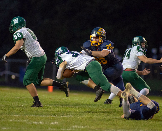 . Aimee Bielozer - The Morning Journal<br> Olmsted Falls\' Dylan Reines brings down Westlake running back James Coleman on Sept. 7.