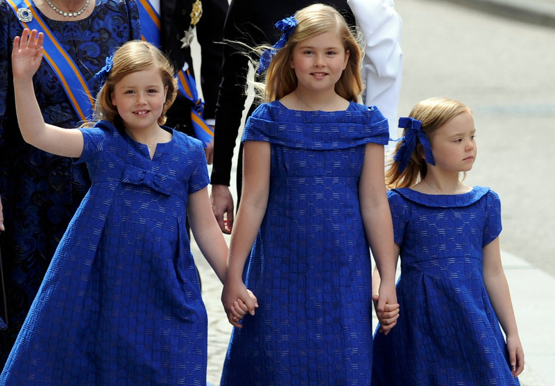 . Crown Princess Catharina-Amalia, (C), Princess Alexia (L) and Princess Ariane arrive at Nieuwe Kerk church before the religious crowning ceremony in Amsterdam April 30, 2013. Queen Beatrix of the Netherlands abdicated on Tuesday, handing over to her eldest son, Willem-Alexander, who became the first King of the Netherlands in over 120 years. REUTERS/Paul Vreeker