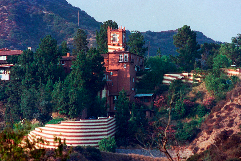 . In this Aug. 16, 1996 file photo, a striped fence highlights Madonna\'s home in Los Angeles. Prosecutors said Robert Dewey Hoskins scaled the walls of Madonna\'s 25,000-square-foot Hollywood Hills estate in April, 1995, and again in May, 1995, and told her assistants he would either marry her or slash her throat from ear to ear.  A bodyguard shot and wounded Hoskins the second time he scaled the wall. (AP Photo/Rene Macura, file)