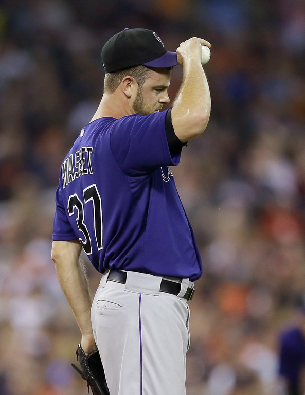 . Colorado Rockies relief pitcher Nick Masset reacts after loading the bases during the seventh inning of an interleague baseball game against the Detroit Tigers, Friday, Aug. 1, 2014, in Detroit. (AP Photo/Carlos Osorio)