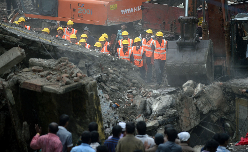 . Indian rescue workers look for survivors at the site of a building collapse in Mumbai on September 27, 2013.  AFP PHOTO/ PUNIT PARANJPE/AFP/Getty Images