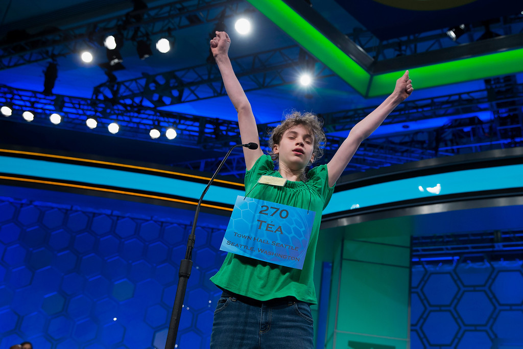 ". Tea Freedman-Susskind of Redmond, Wash., celebrates after spelling ""camembert\"" during the semifinal round of the National Spelling Bee, on Thursday, May 29, 2014, in Oxon Hill, Md. (AP Photo/ Evan Vucci)"