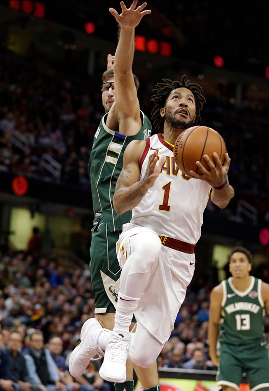. Cleveland Cavaliers\' Derrick Rose (1) drives to the basket against Milwaukee Bucks\' Mirza Teletovic (35), from Bosnia, in the first half of an NBA basketball game, Tuesday, Nov. 7, 2017, in Cleveland. (AP Photo/Tony Dejak)
