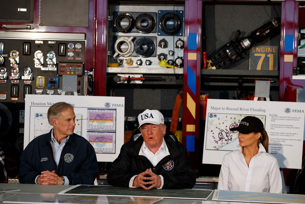 . President Donald Trump, flanked by Texas Gov. Greg Abbott and first lady Melania Trump, speaks during a briefing on Harvey relief efforts, Tuesday, Aug. 29, 2017, in Corpus Christi, Texas. (AP Photo/Evan Vucci)