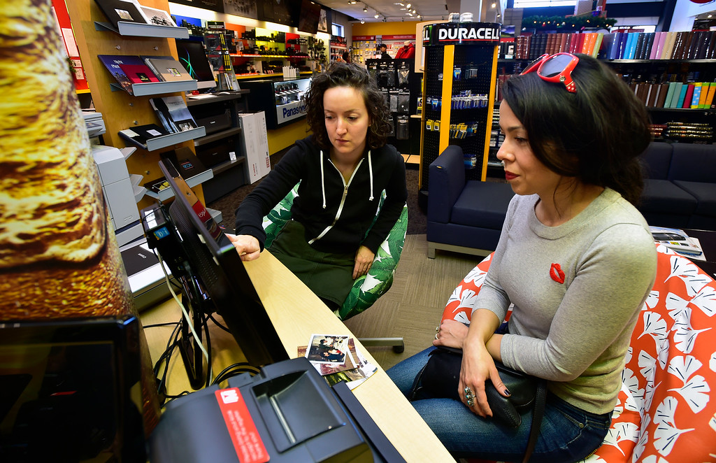 . BOULDER, CO. NOVEMBER 14, 2018 Sophia Benedetto, left, helps Tonya Yarrow with the photo scanner at Mike\'s Camera in Boulder on Wednesday morning. Yarrow wanted to scan some old family photos.  (Photo by Paul Aiken/Staff Photographer)
