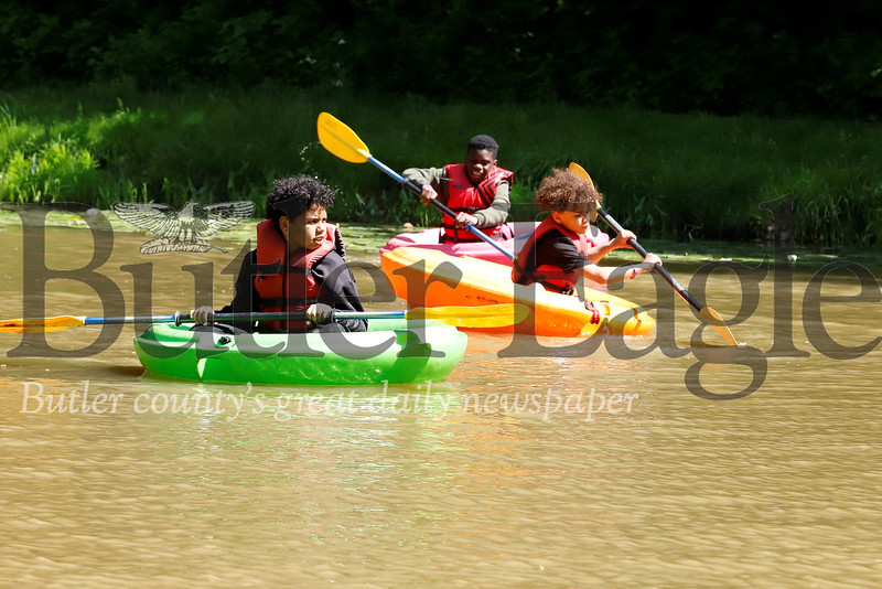 Shann Israel (left) of Harmomy, Ivyuan Johnson (right) of Erie and Jordell Cabbage of Pittsburgh(center) enjoy a sunny day paddling on the pond at YMCA Camp Kon-O-Kee as part of Allegheny Health Networks burn camp. Seb Foltz/Butler Eagle