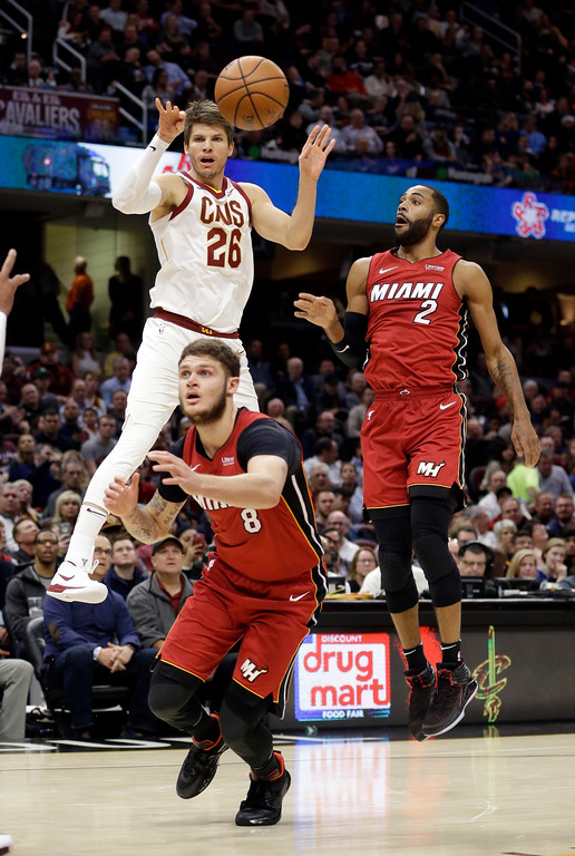 . Cleveland Cavaliers\' Kyle Korver (26) passes against Miami Heat\'s Tyler Johnson (8) and Wayne Ellington (2) in the first half of an NBA basketball game, Tuesday, Nov. 28, 2017, in Cleveland. (AP Photo/Tony Dejak)