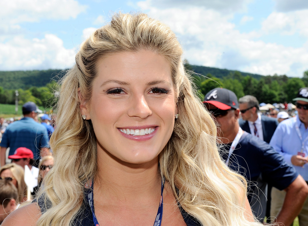 . Taylor Jones wife of National Baseball Hall of Fame inductee Chipper Jones, is seen during an induction ceremony at the Clark Sports Center on Sunday, July 29, 2018, in Cooperstown, N.Y. (AP Photo/Hans Pennink)