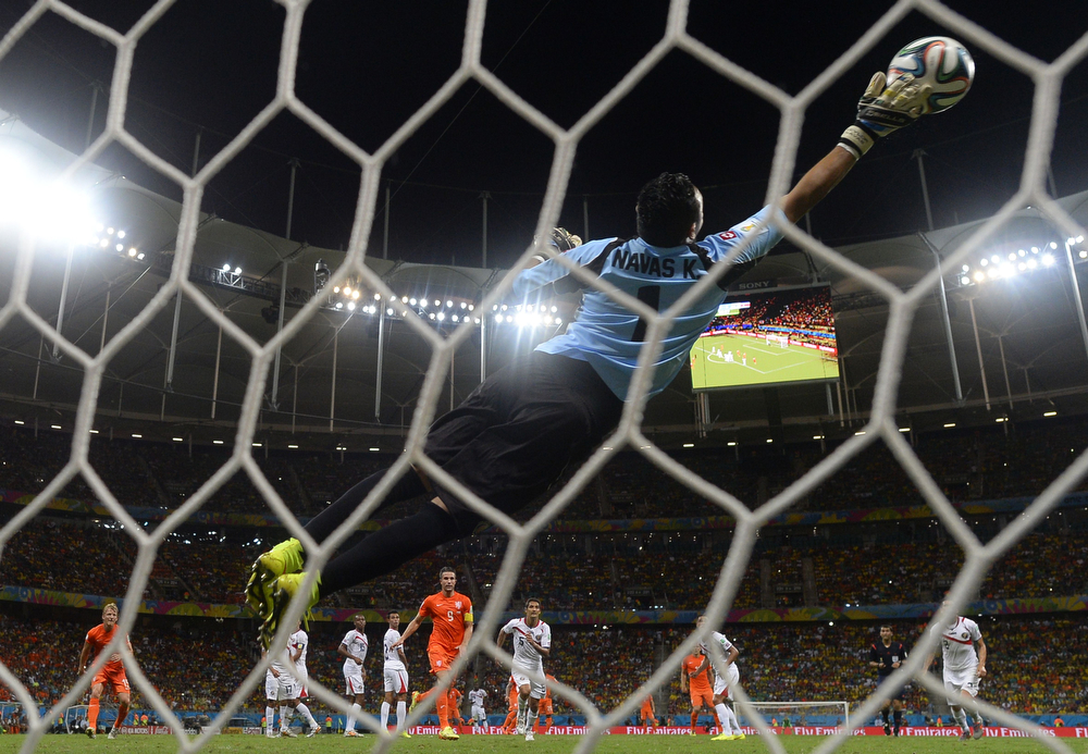 . Costa Rica\'s goalkeeper Keylor Navas makes a save during a quarter-final football match between Netherlands and Costa Rica at the Fonte Nova Arena in Salvador during the 2014 FIFA World Cup on July 5, 2014. (ODD ANDERSEN/AFP/Getty Images)