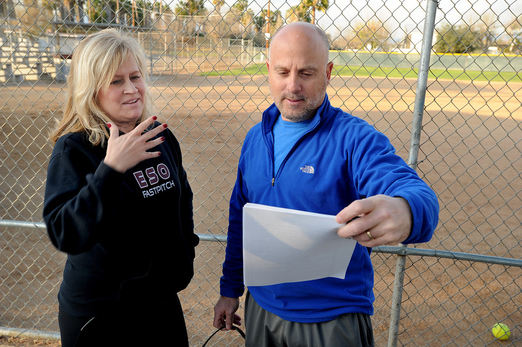 . Lynette Rice and Larry Slade consider legal paperwork. A dispute has erupted between the nonprofit Encino-Sherman Oaks Softball � a four-year-old, award-winning fast-pitch league serving girls--and Mid-Valley Boys Baseball, which operates at the same complex at 17301  Oxnard St. Encino CA. February 5, 2014 (Photo by John McCoy / Los Angeles Daily News)