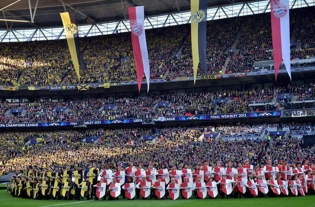 . Performers line up during the opening ceremony for the Champions League Final soccer match between  Borussia Dortmund and Bayern Munich, at Wembley Stadium in London, Saturday May 25, 2013. (AP Photo/Martin Meissner)