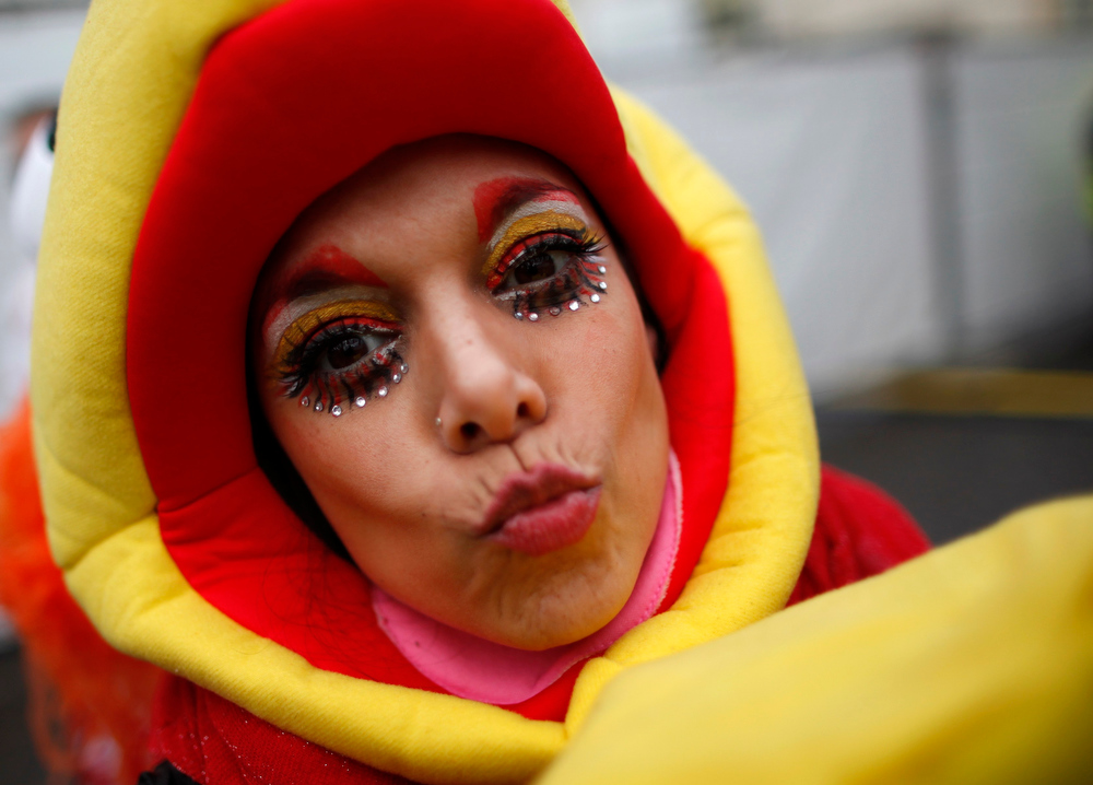 ". A woman in costume celebrates ""Weiberfastnacht\"" (Women\'s Carnival) in Cologne February 7, 2013. Women\'s Carnival marks the start of a week of street festivals, the highlight of the event being \""Rosenmontag\"" (Rose Monday), the final day of the carnival where mass processions are held. REUTERS/Ina Fassbender"