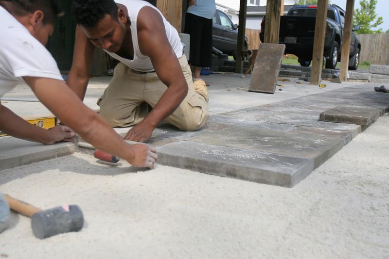 Benito and Mo laying pavers