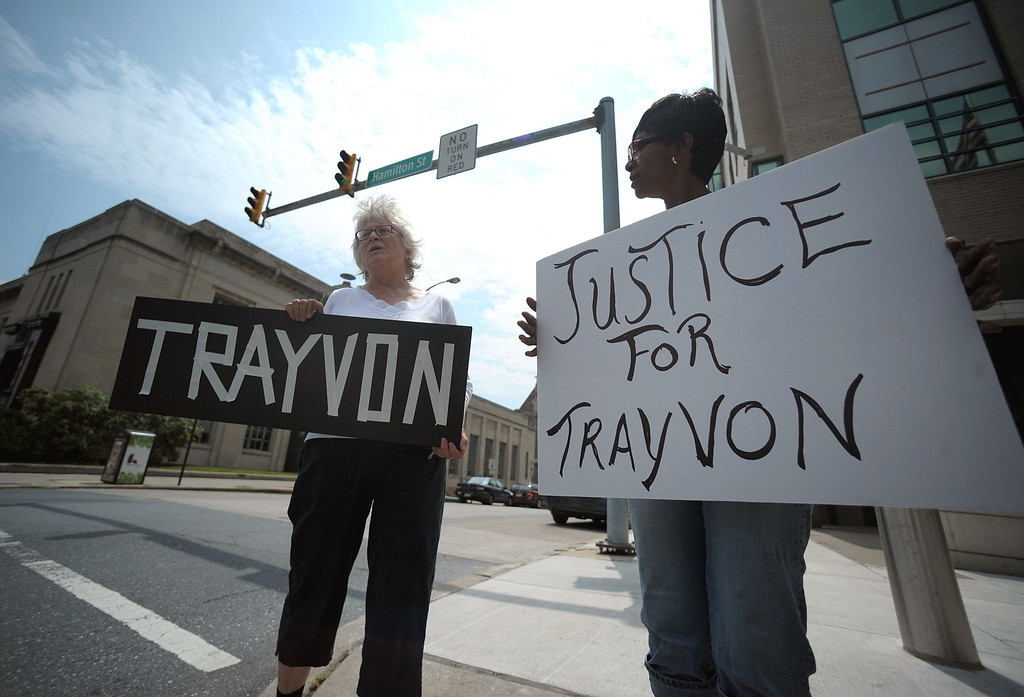 """. Allentown, PA, July 20th, 2013. Judith Joy Ross, left, of Bethlehem, and Darlene Banks, right, of Pottstown, hold signs during a \""""Justice for Trayvon\"""" vigil at the Edward N. Cahn U.S. Courthouse & Federal Building in Allentown, Pa. on Saturday, July 20, 2013. Martin was a black Florida teen who was shot and killed by George Zimmerman, who said he shot the 17-year-old in self-defense. Zimmerman was acquitted of all charges. (AP Photo/The Express-Times, Matt Smith)"""