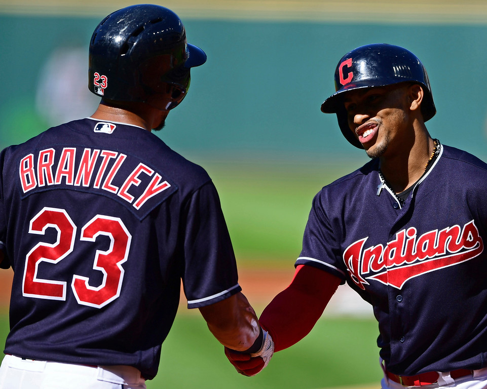 . Cleveland Indians\' Francisco Lindor, right, is congratulated by Michael Brantley after hitting a solo home run in the first inning of a baseball game against the Detroit Tigers, Saturday, Sept.15, 2018, in Cleveland. (AP Photo/David Dermer)