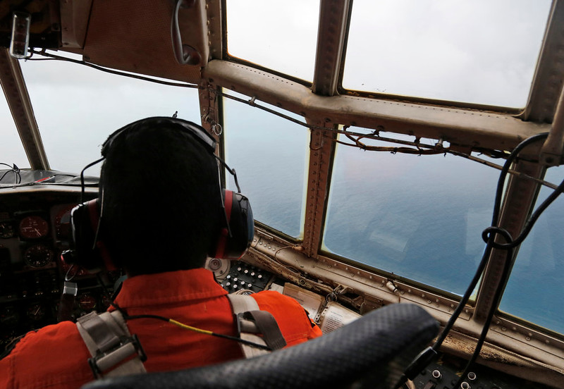 . A crew of an Indonesian Air Force C-130 airplane of the 31st Air Squadron scans the horizon during a search operation for the missing AirAsia flight 8501 jetliner over the waters of Karimata Strait in Indonesia, Monday, Dec. 29, 2014. Search planes and ships from several countries on Monday were scouring Indonesian waters over which an AirAsia jet disappeared, more than a day into the region\'s latest aviation mystery. AirAsia Flight 8501 vanished Sunday in airspace thick with storm clouds on its way from Surabaya, Indonesia, to Singapore. (AP Photo/Dita Alangkara)