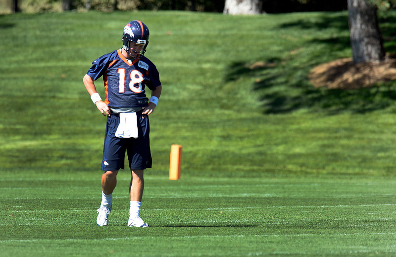 . Quarterback Peyton Manning (18) of the Denver Broncos stands away from the action during OTAs June 6, 2013 at Dove Valley. (Photo By John Leyba/The Denver Post)